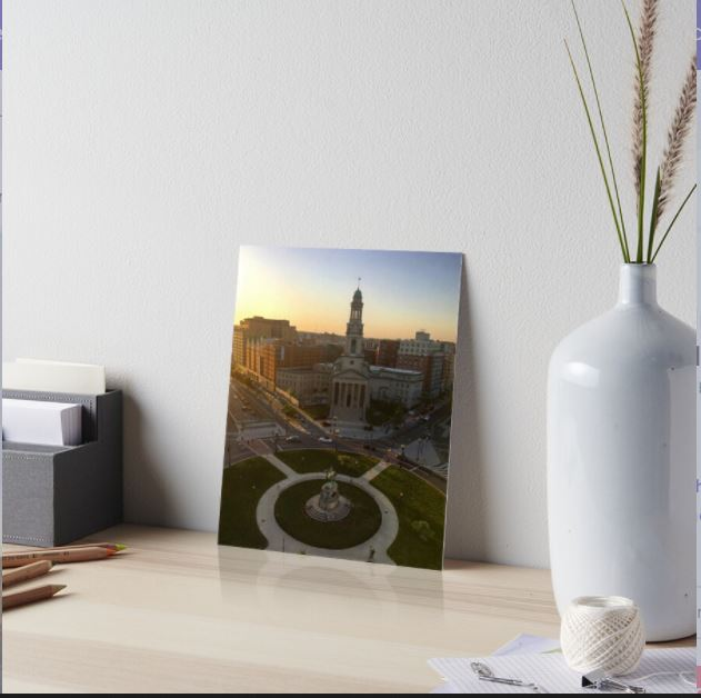 Photo shows a picture of art (a photo) on a desk to show how the art may look inside someone's home